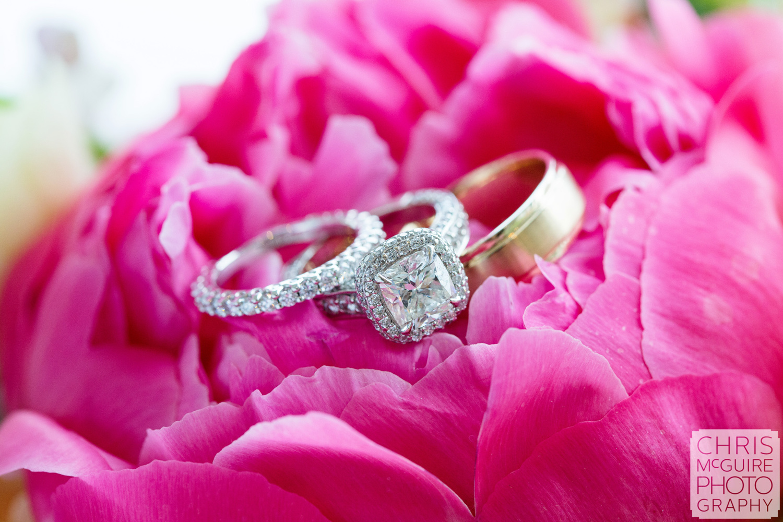 wedding rings on pink flower