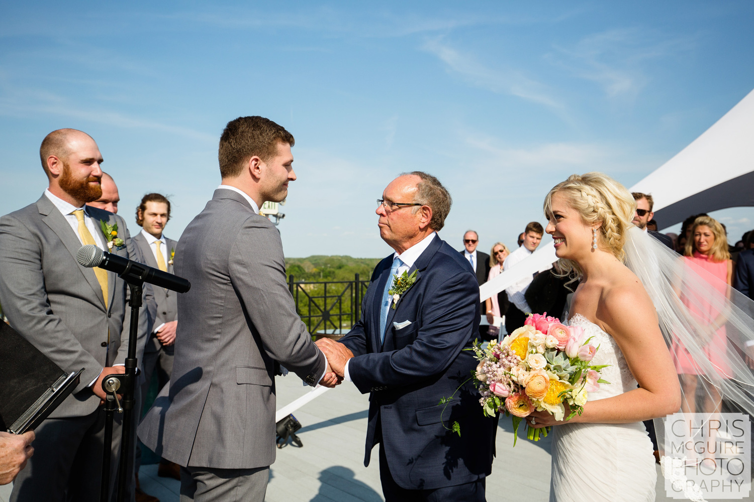 groom and bride's father shake hands at wedding