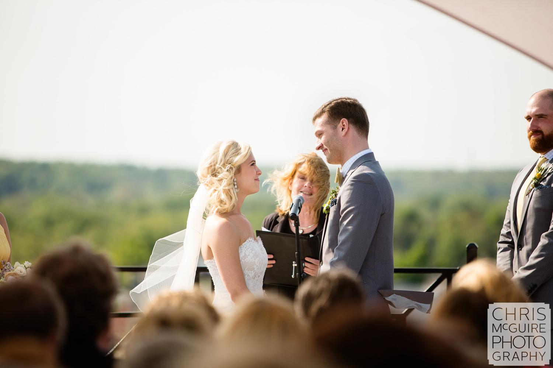 bride groom during wedding ceremony on rooftop