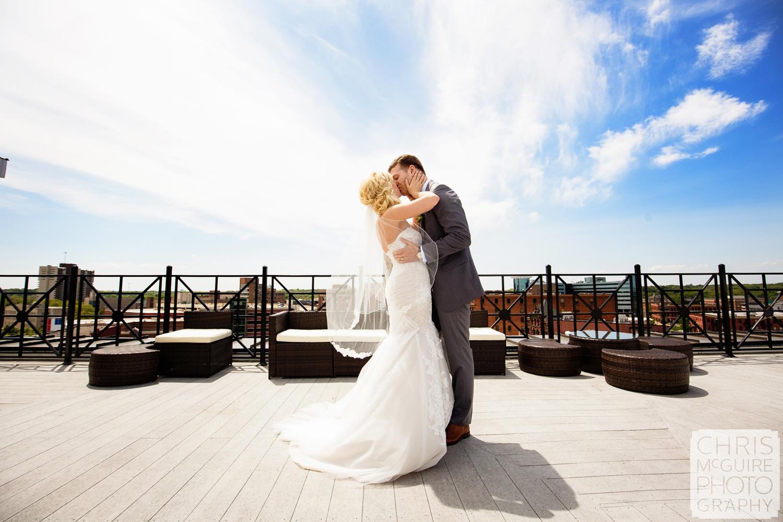 bride groom kiss on  roof