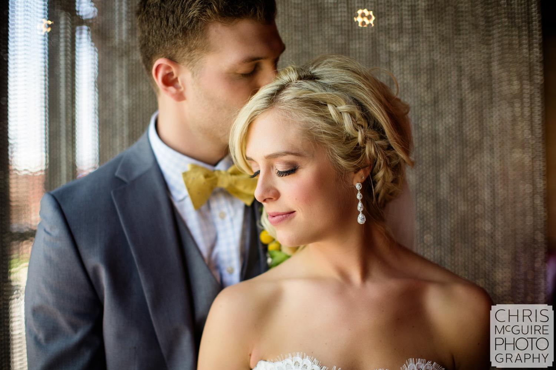 groom kisses bride's head