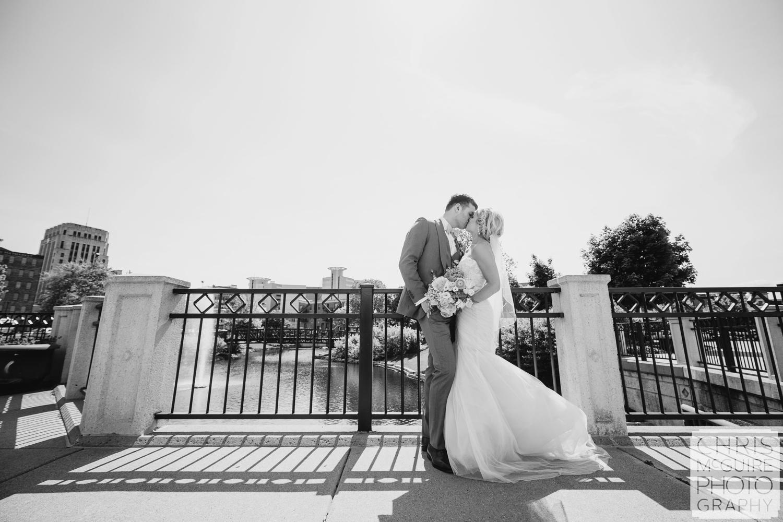 bride groom kiss by river