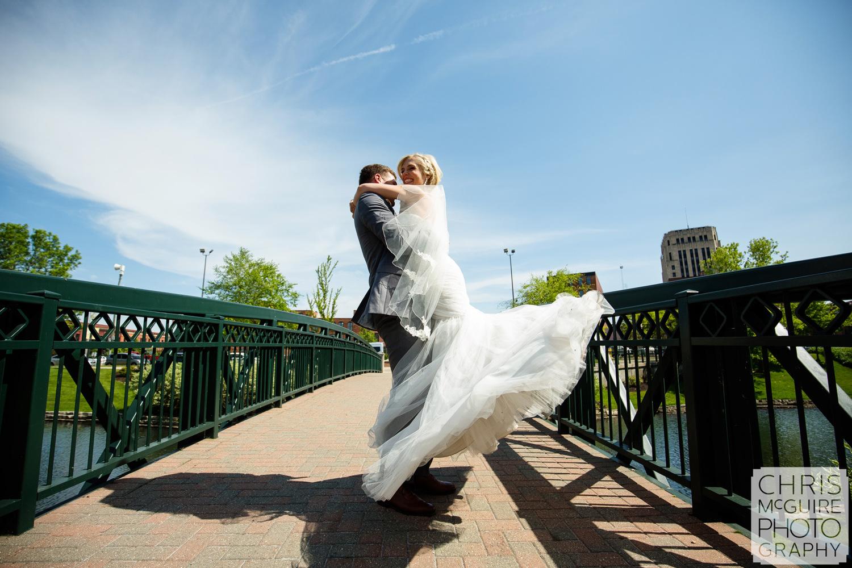 bride groom twirl on bridge
