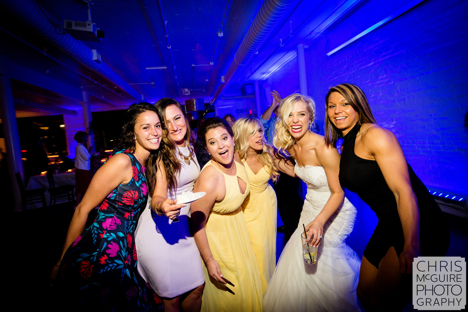 bride with friends at wedding reception