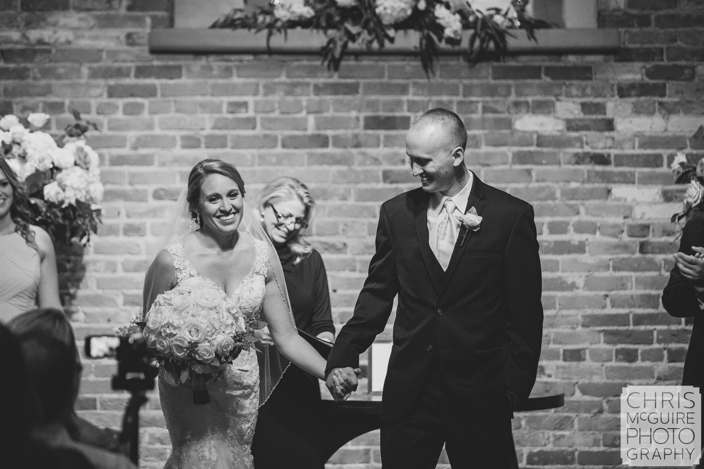 bride groom laugh during wedding ceremony