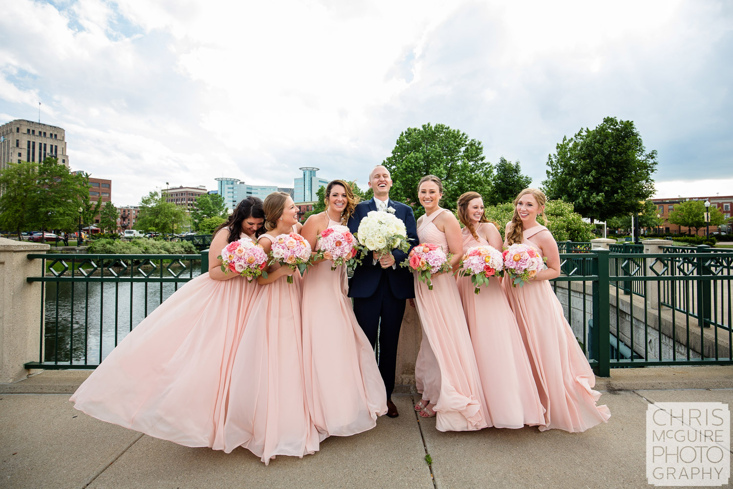 groom and bridesmaids laughing