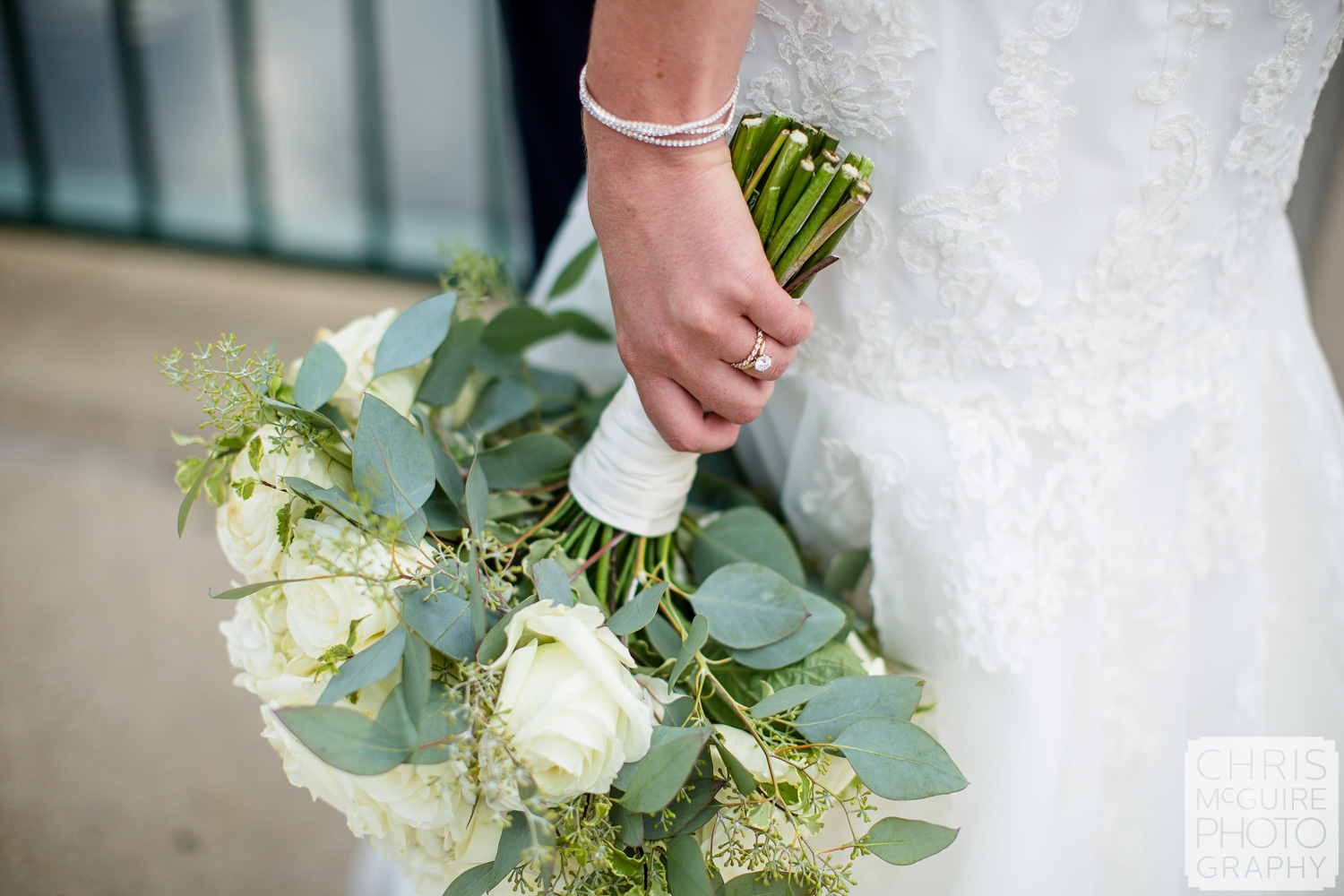 bridal bouquet and wedding ring