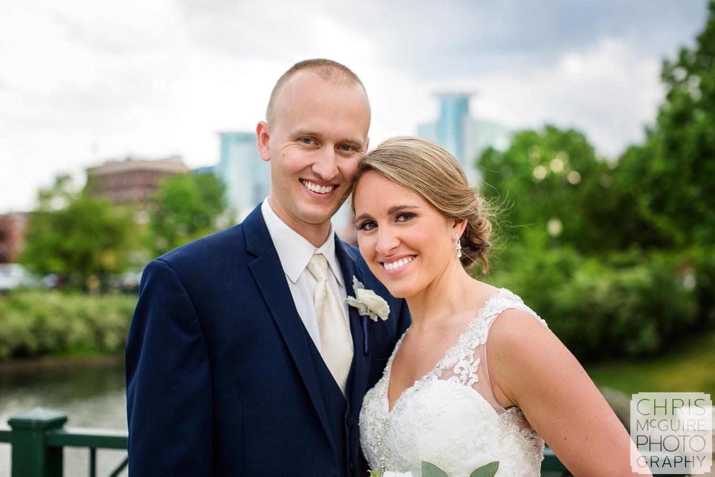 bride groom smiling downtown