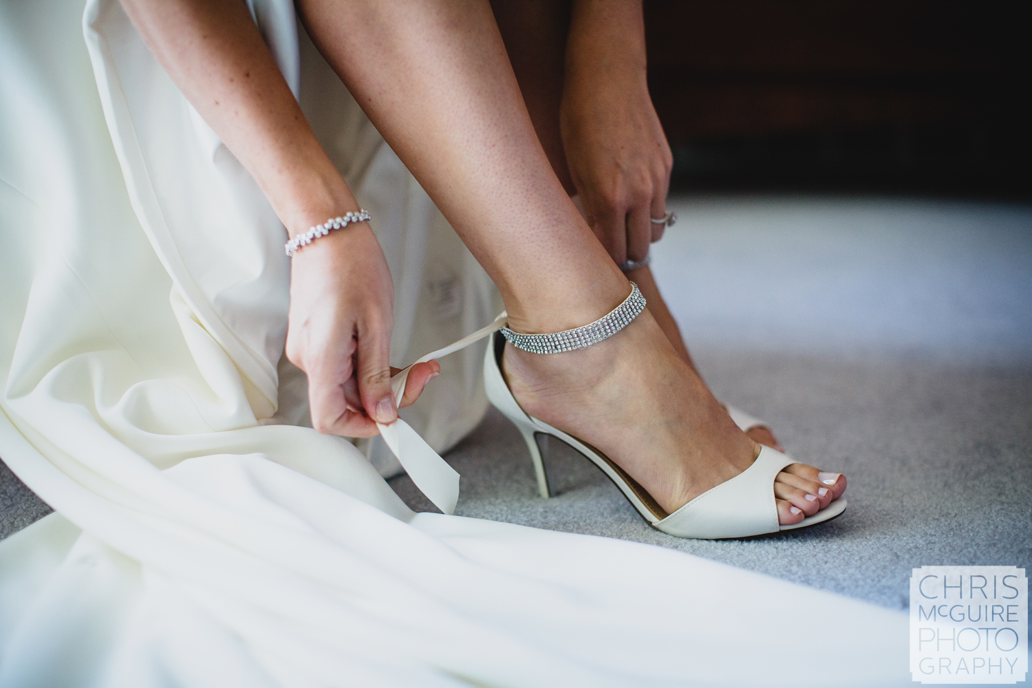 bride putting on white shoes
