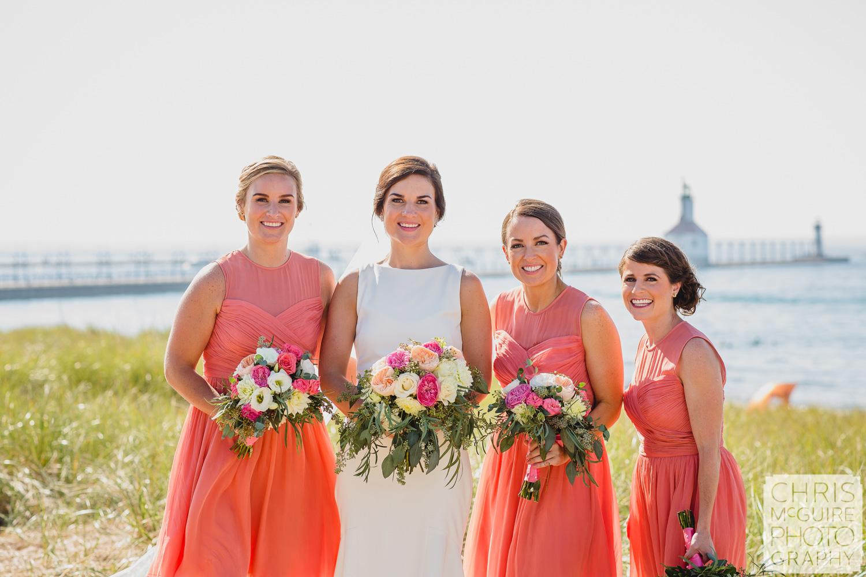 bride bridesmaids by lake