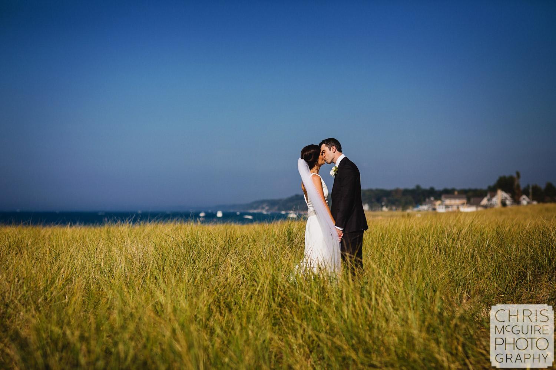 bride groom kiss at lake michigan