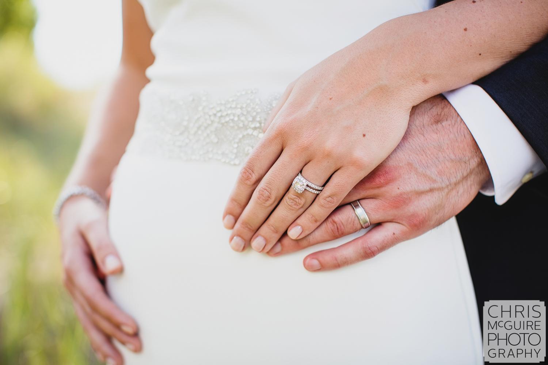 bride groom hands with wedding rings