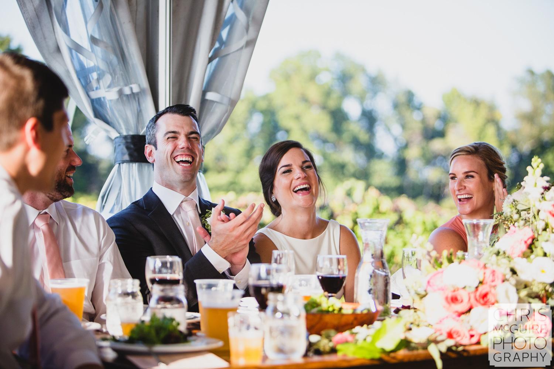 bride groom laugh during toast
