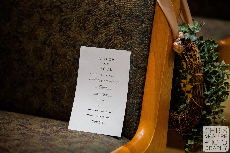 wedding program on pew