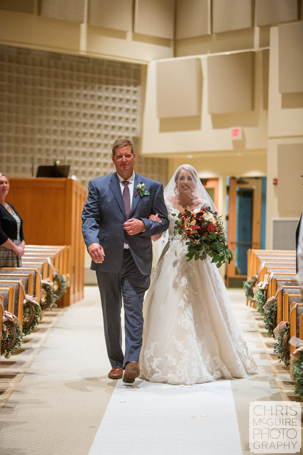 bride with father walking down aisle