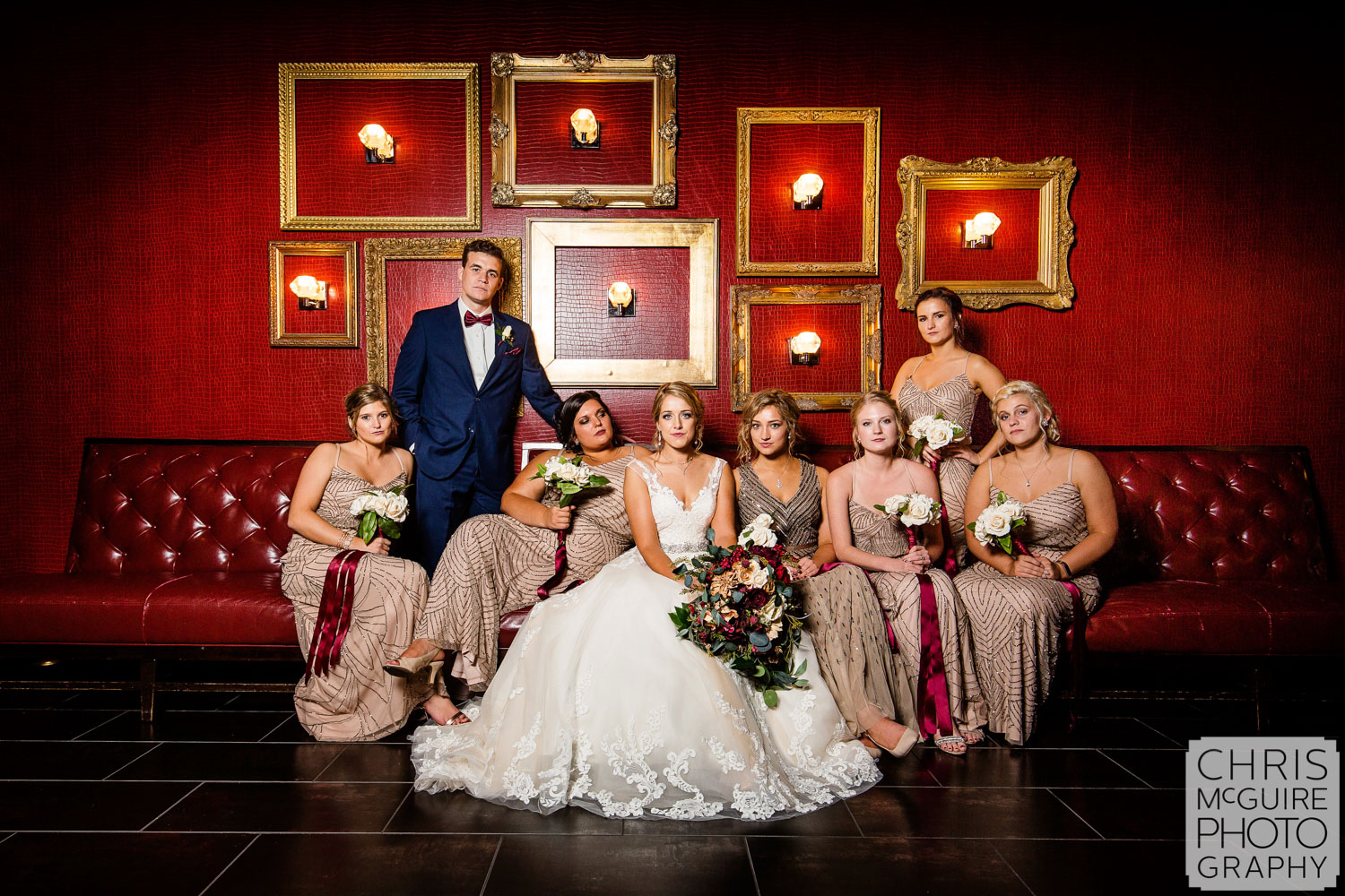 bridal party with red wall
