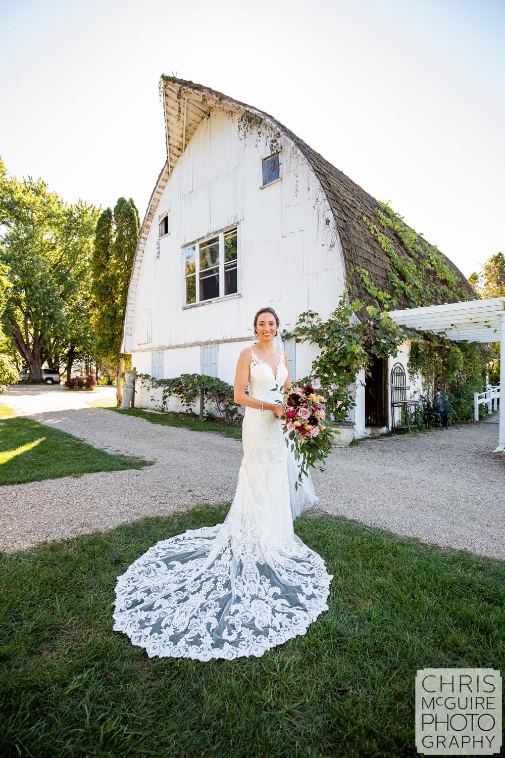 bridal portrait in front of white barn midwest