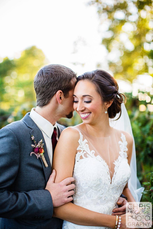 intimate portrait of bride and groom at vineyard