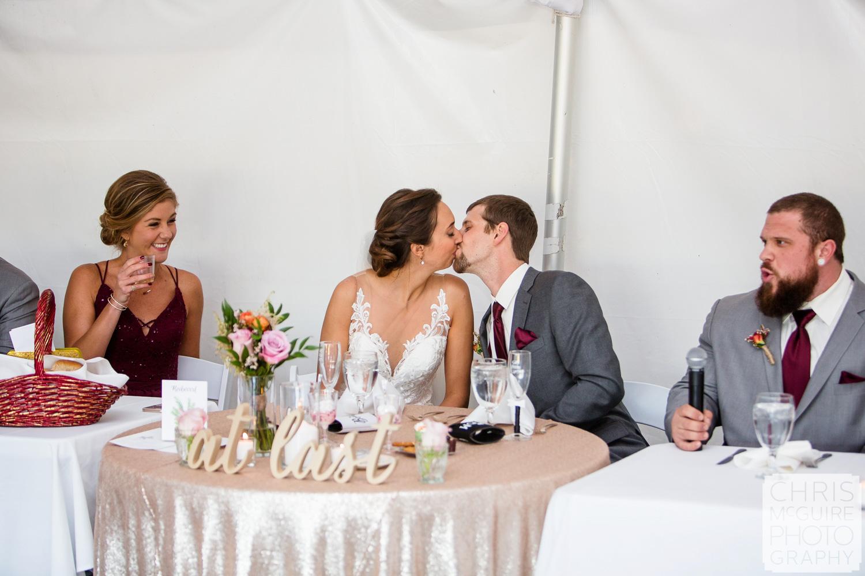 bride groom kiss at reception