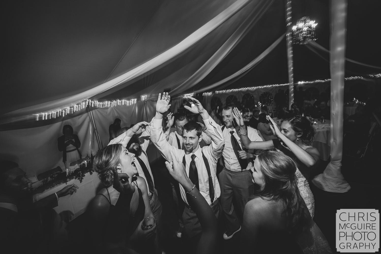 groom dances at wedding