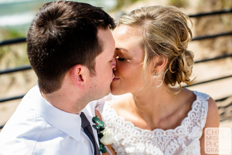 bride groom kiss at beach