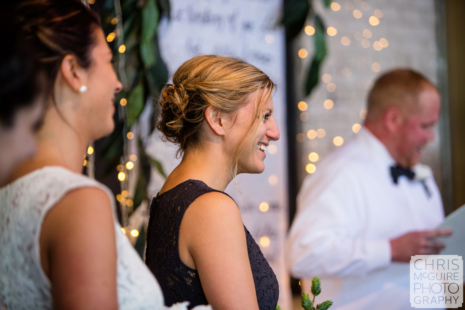 maid of honor laughs during ceremony