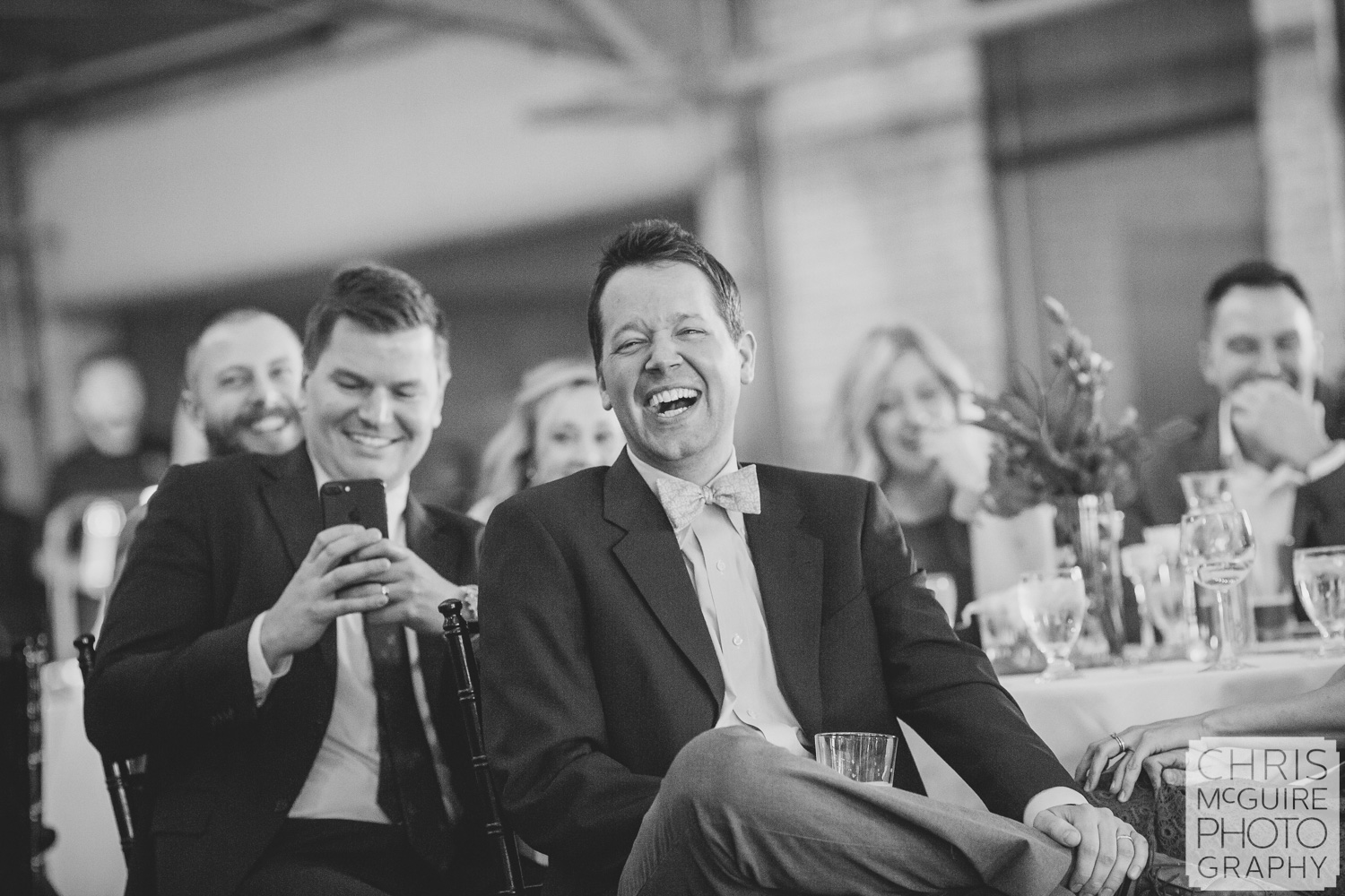 guests laugh during wedding toast
