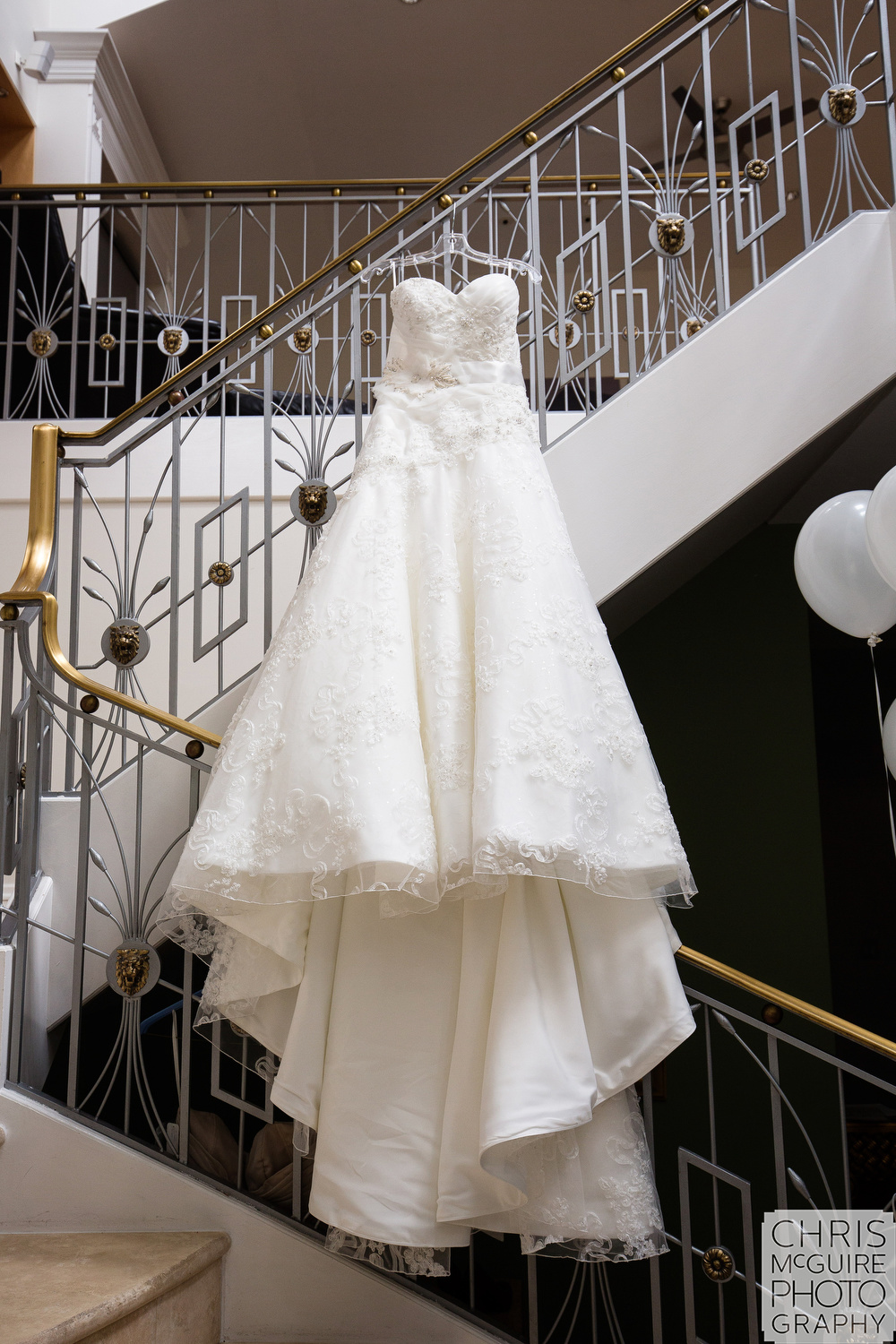 Chicago wedding dress hanging on stairs