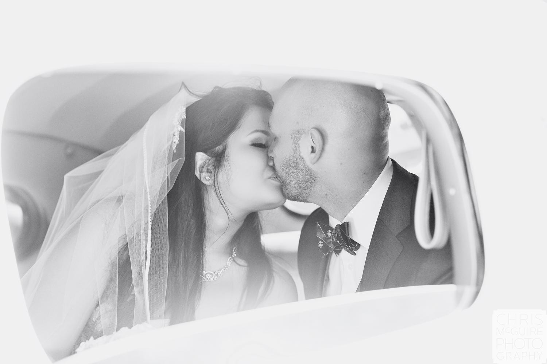 Central Illinois Wedding Photographer bride groom kiss in packard
