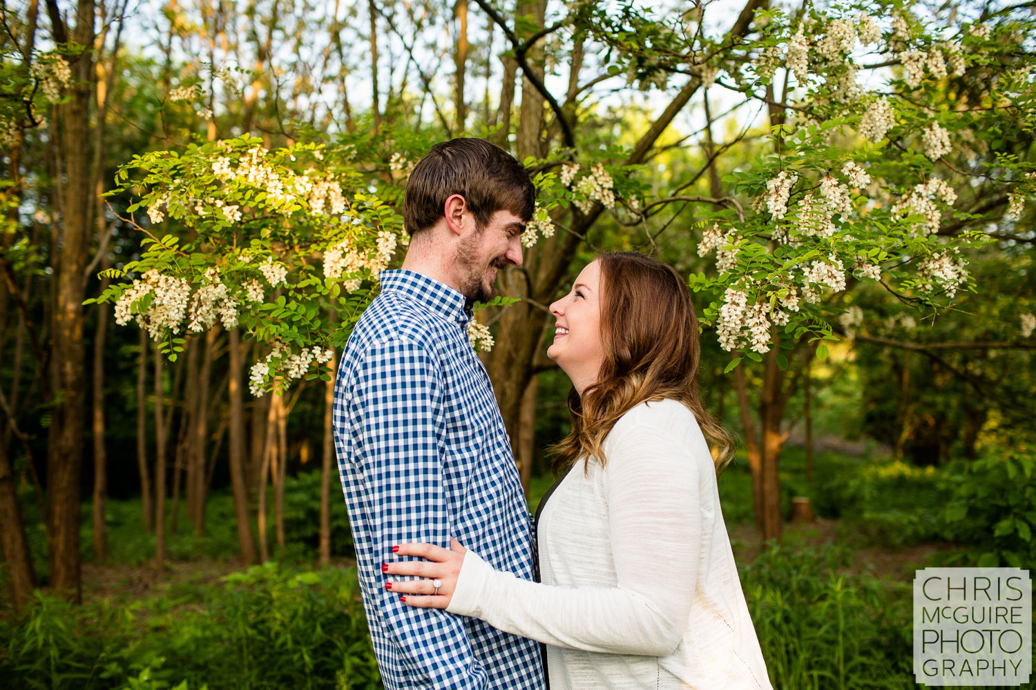 couple with flowering tree