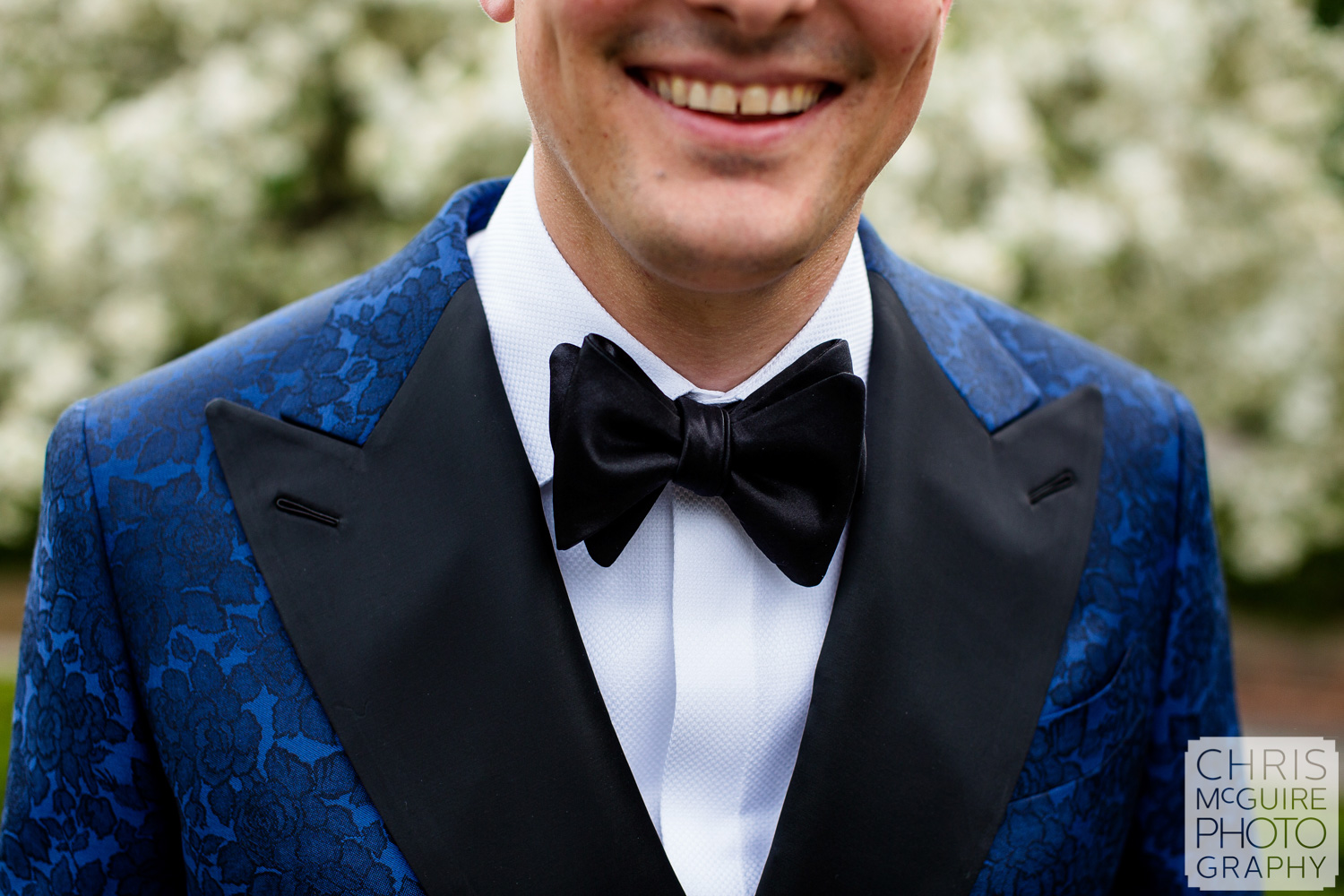 groom with blue jacket bow tie