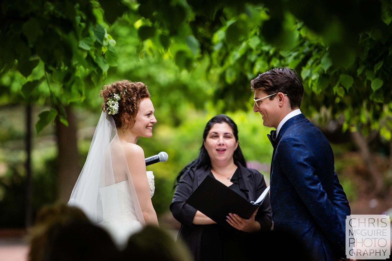 bride and groom smile at Chicago Botanic Gardens wedding