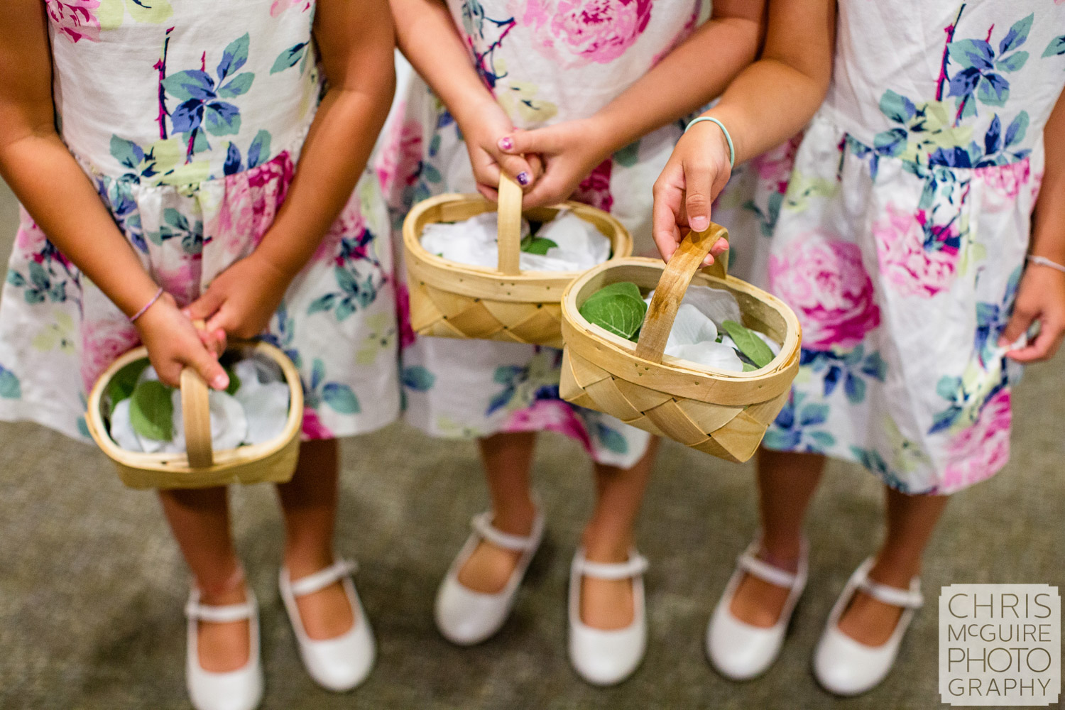flower girls with baskets of petals