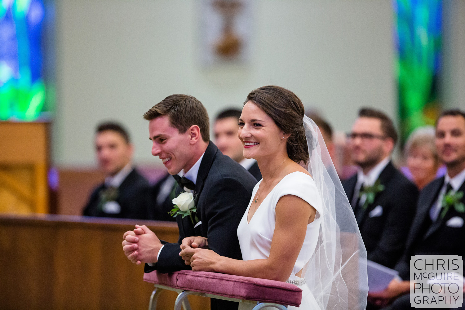 bride and groom laugh at Blessed Sacrament wedding