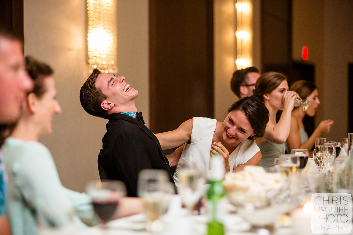 bride and groom laugh during toasts at Pere Marquette wedding