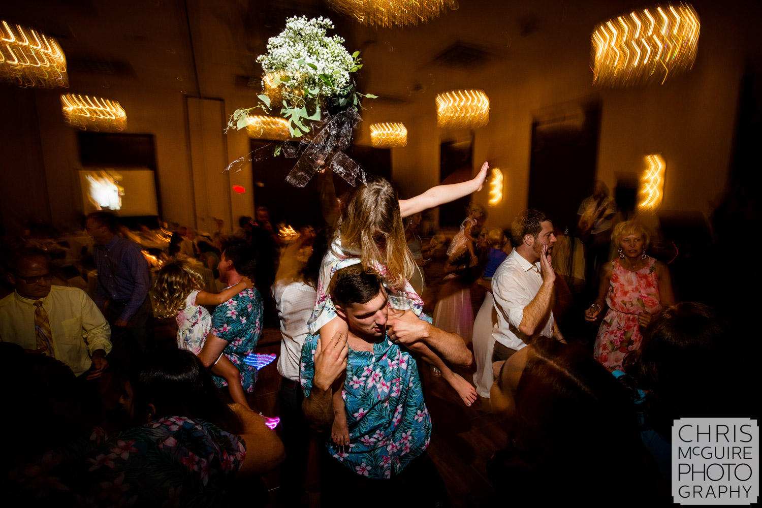 flower girl dancing at Pere Marquette ballroom wedding reception