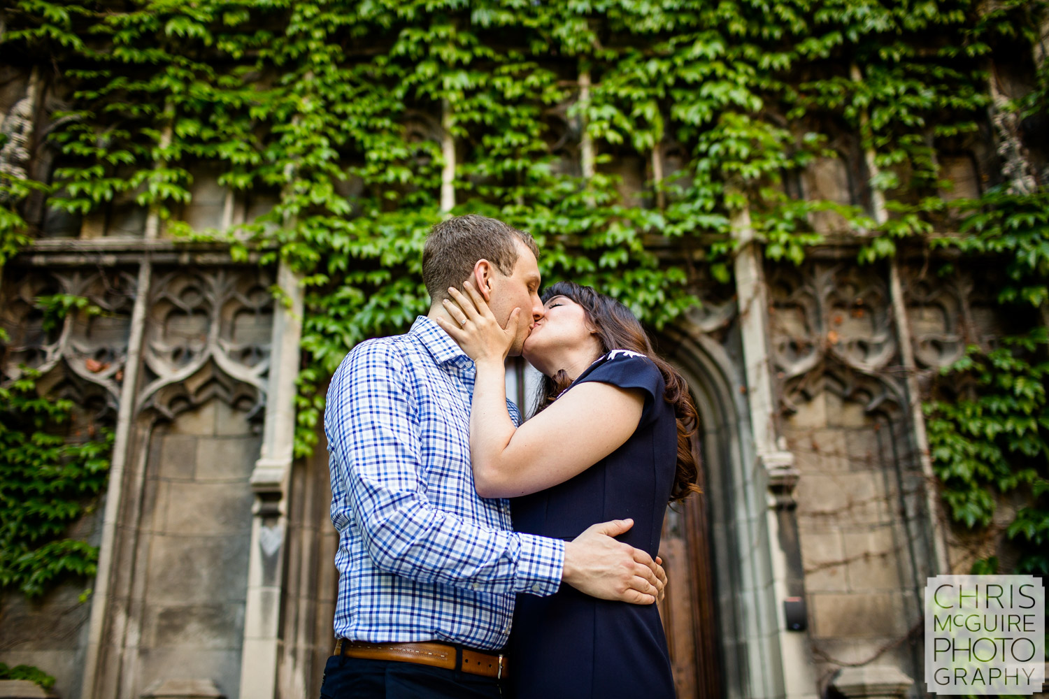 couple kissing at university of chicago gothic ivy