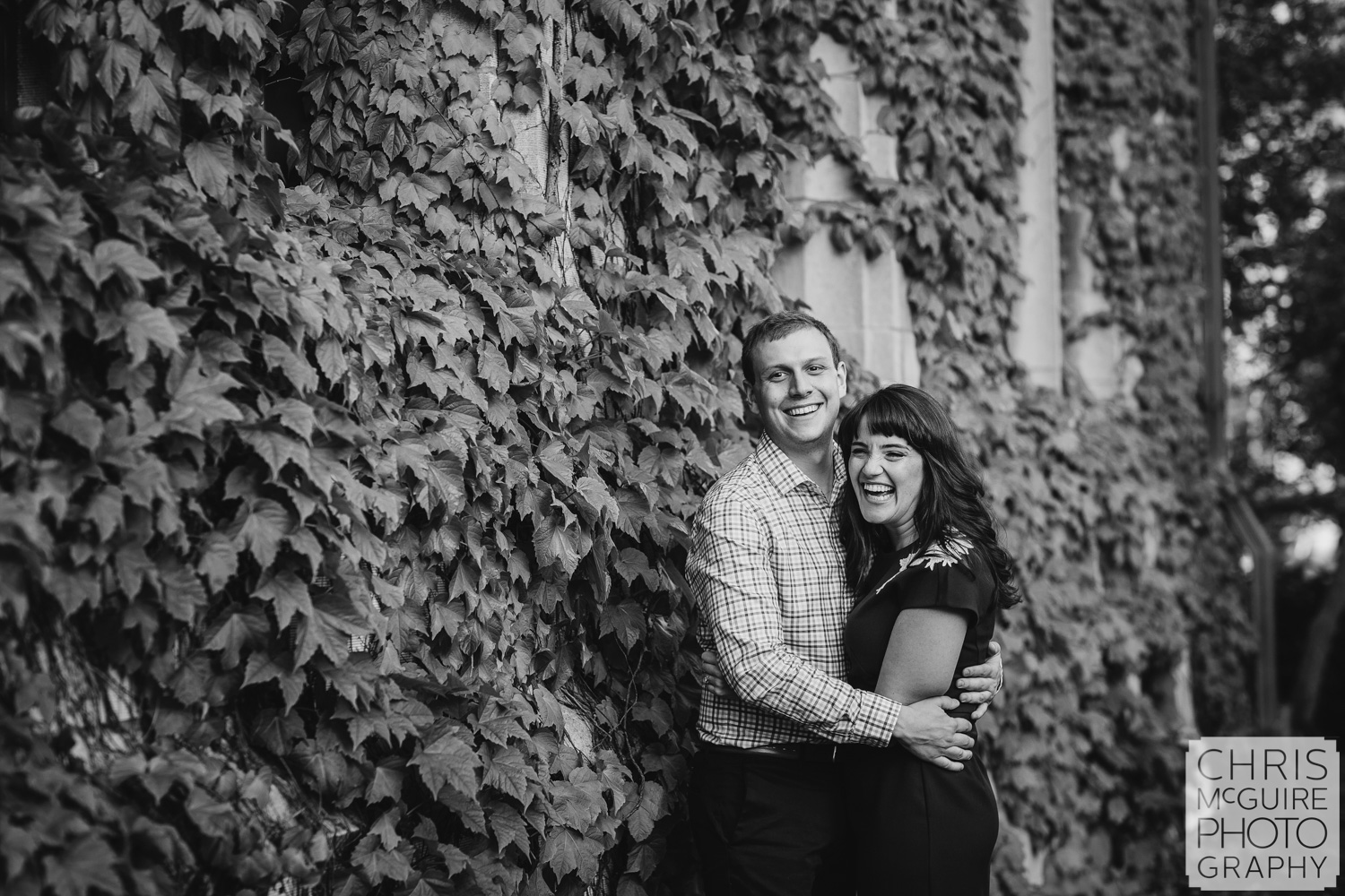 couple laughing by ivy wall at university of chicago