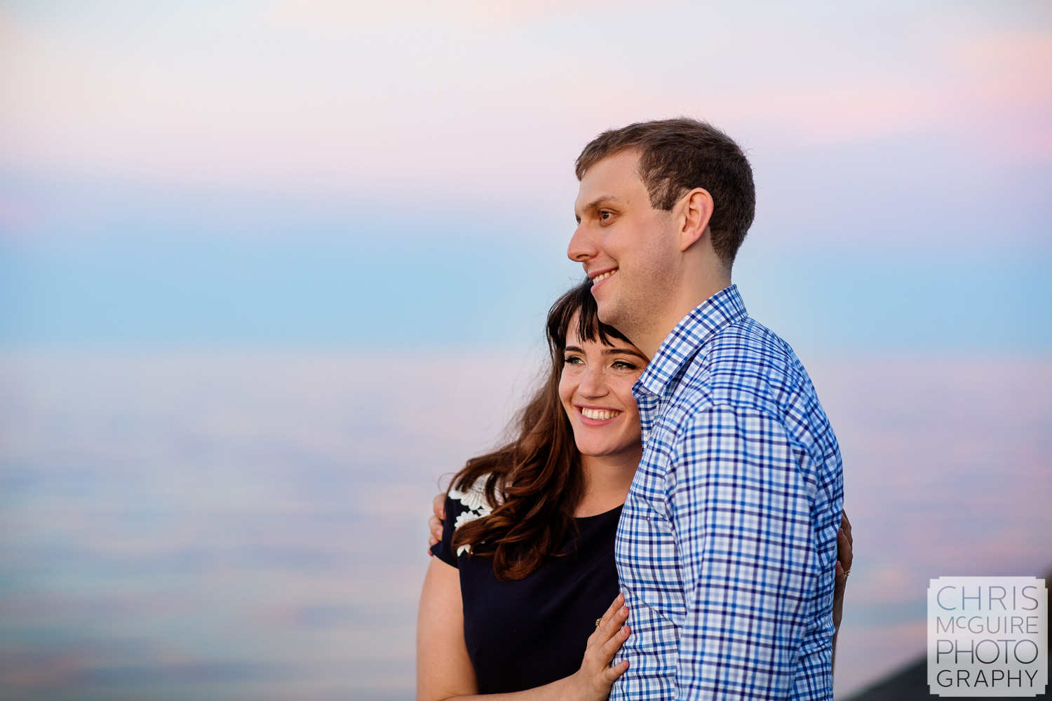 couple at sunset by lake michigan in chicago IL