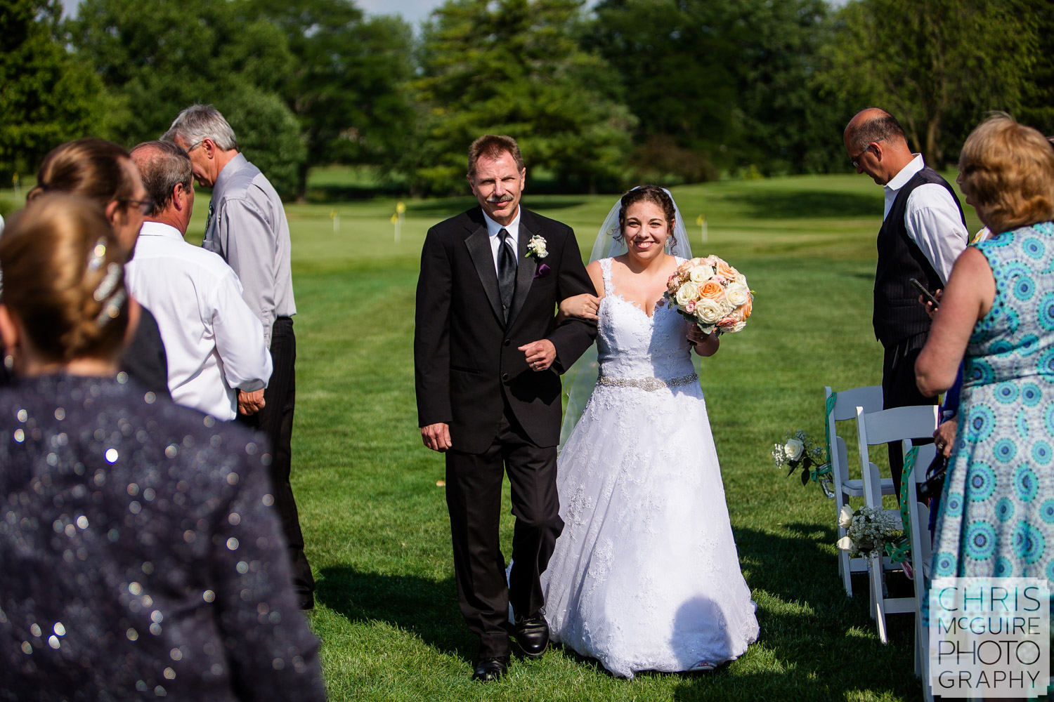 bride and father walk down aisle Bloomington IL wedding