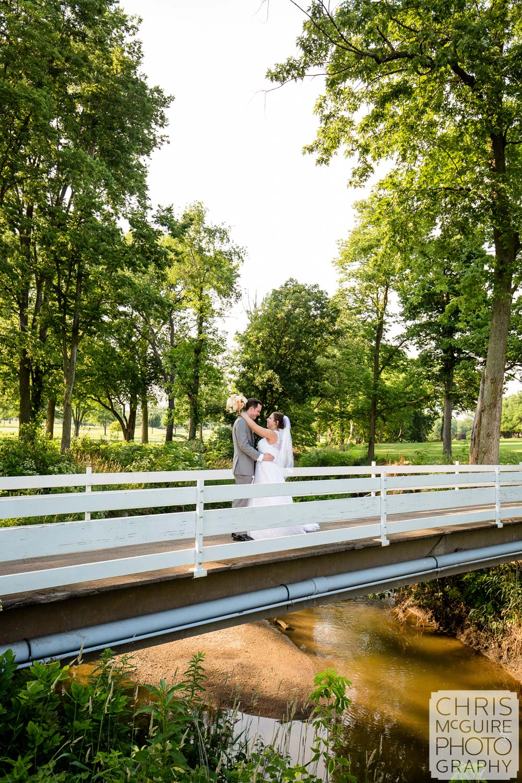 bride groom on white bridge Crestwicke Country Club
