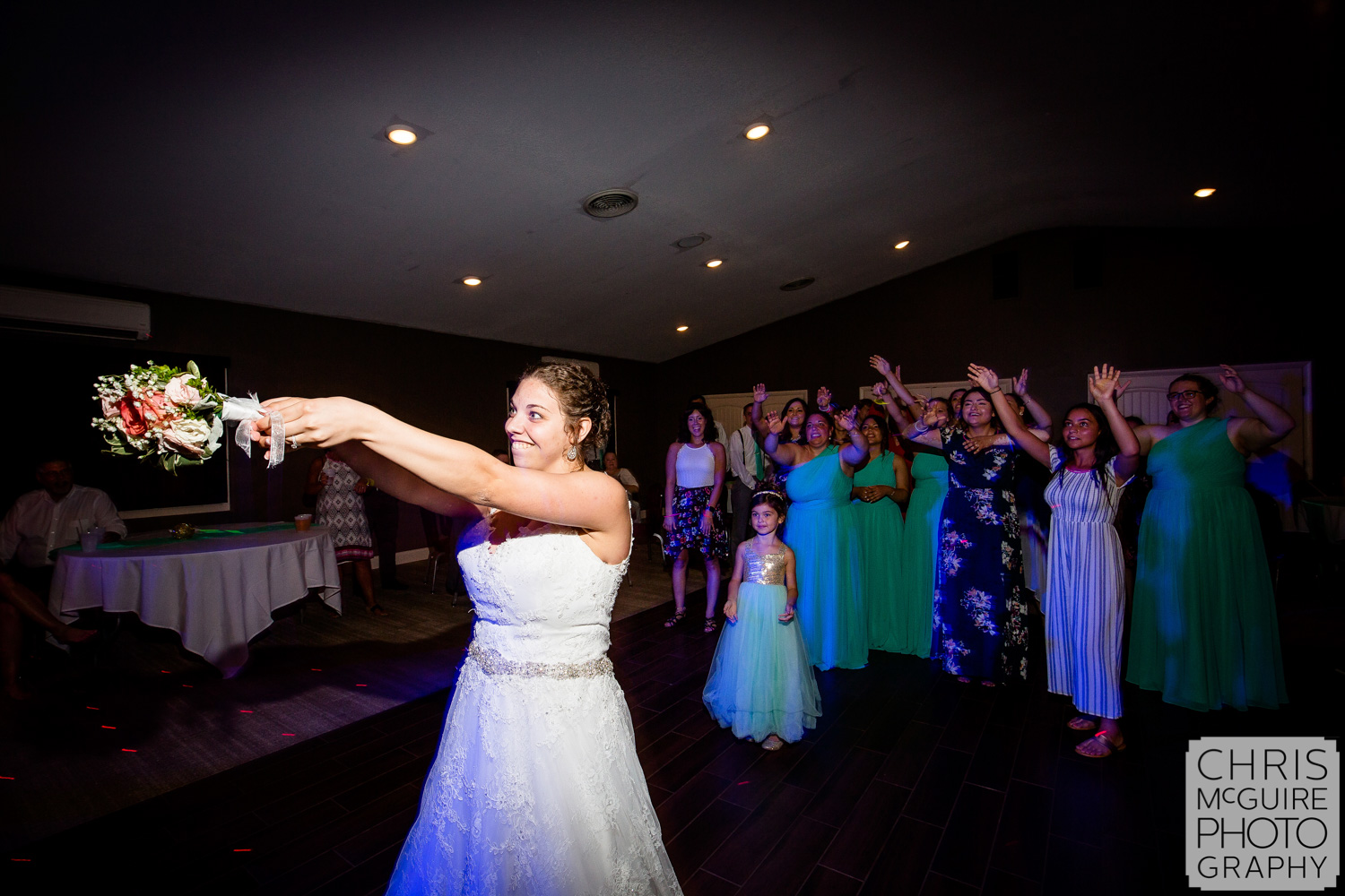 bouquet toss at midwest wedding