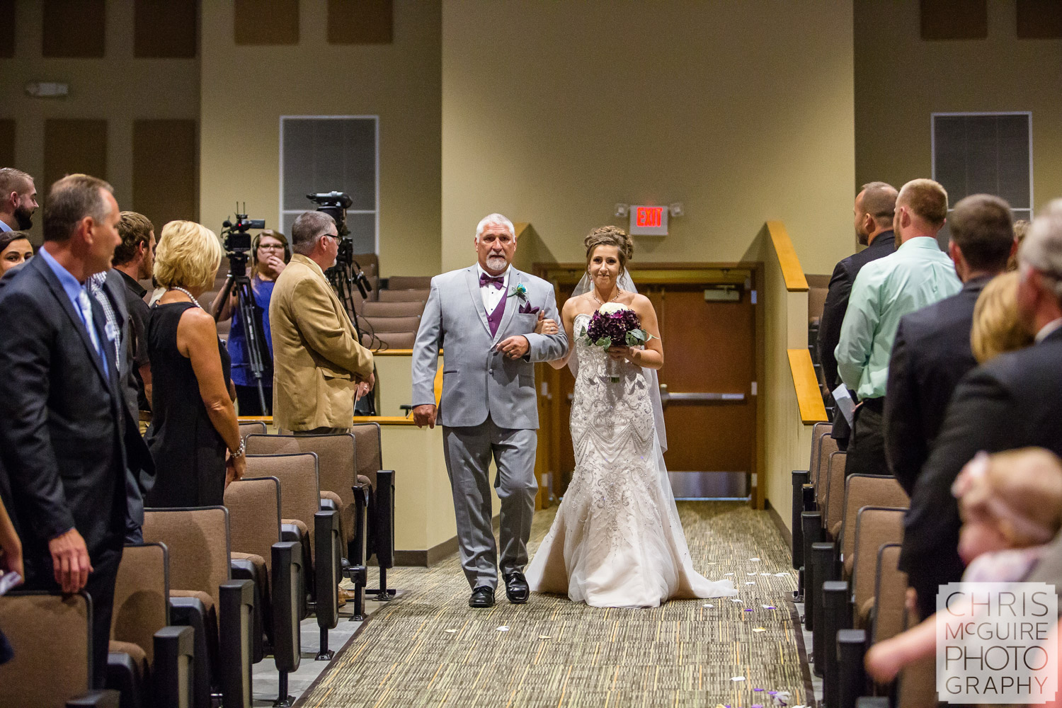 bride and father walking down asle at Peoria wedding
