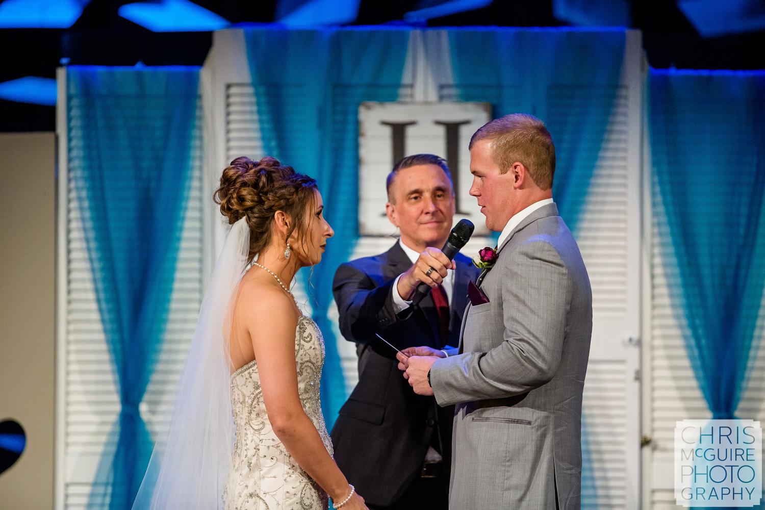 exchange of vows at Harvest Bible Chapel Peoria IL Wedding