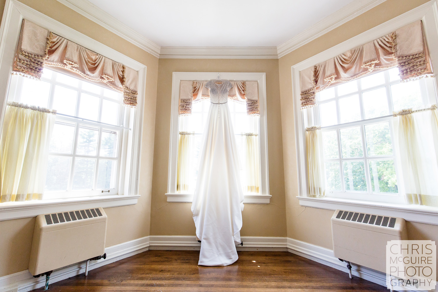 Wedding dress hanging at Allerton Mansion
