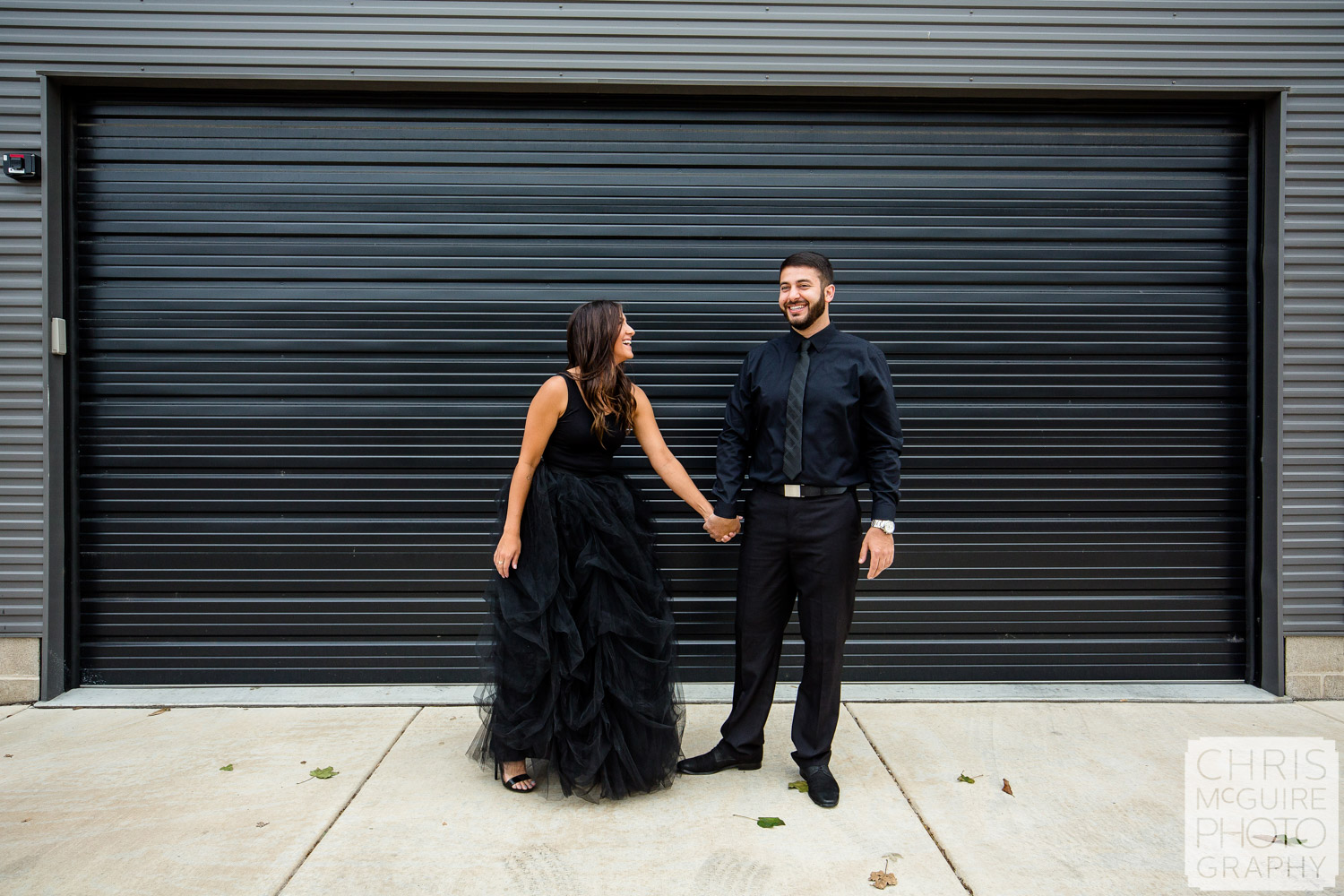 couple laughs wearing black