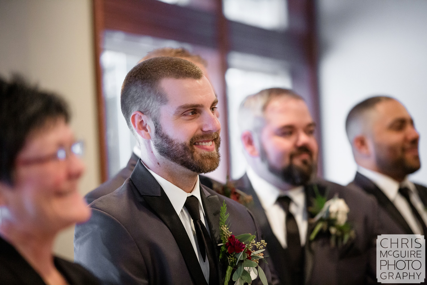 Groom's reaction to bride in aisle