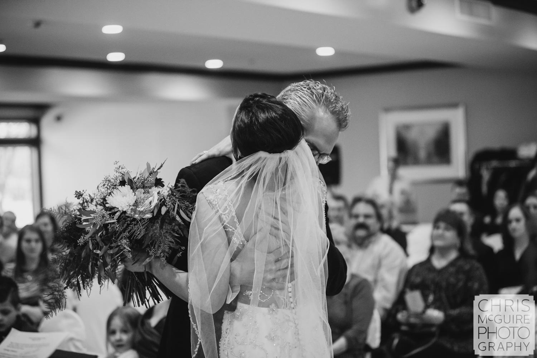 bride hugs father at Weaver Ridge wedding