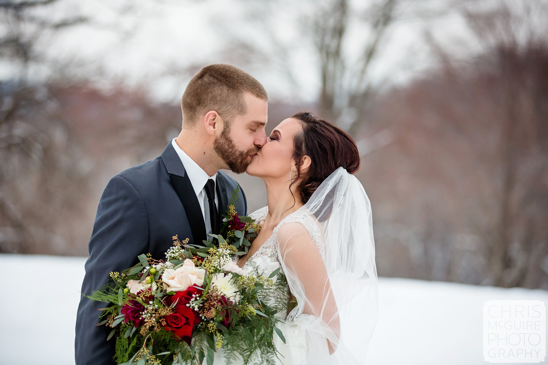 Weaver Ridge Winter Wedding Kiss
