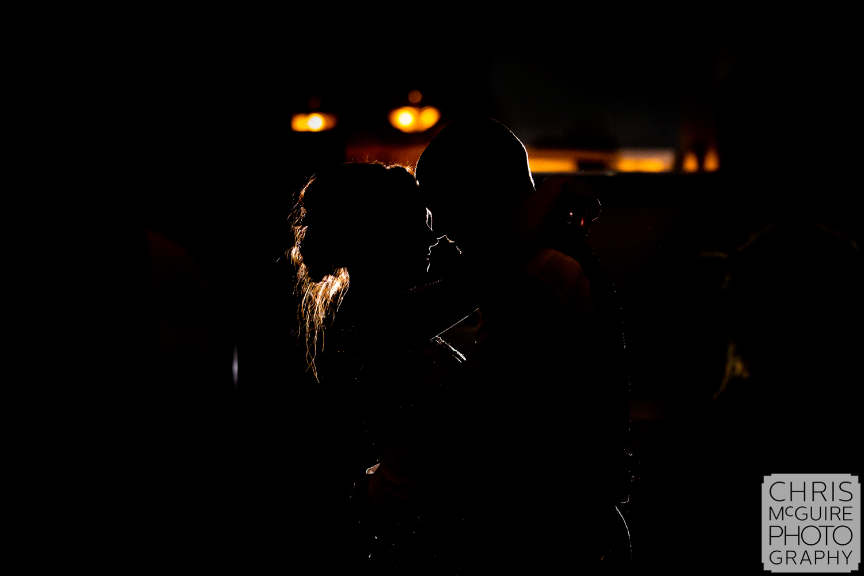 Bride and groom rim light on dancefloor